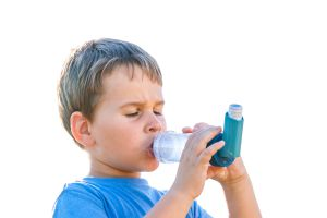 Asthmatic child using MDI and inhaler