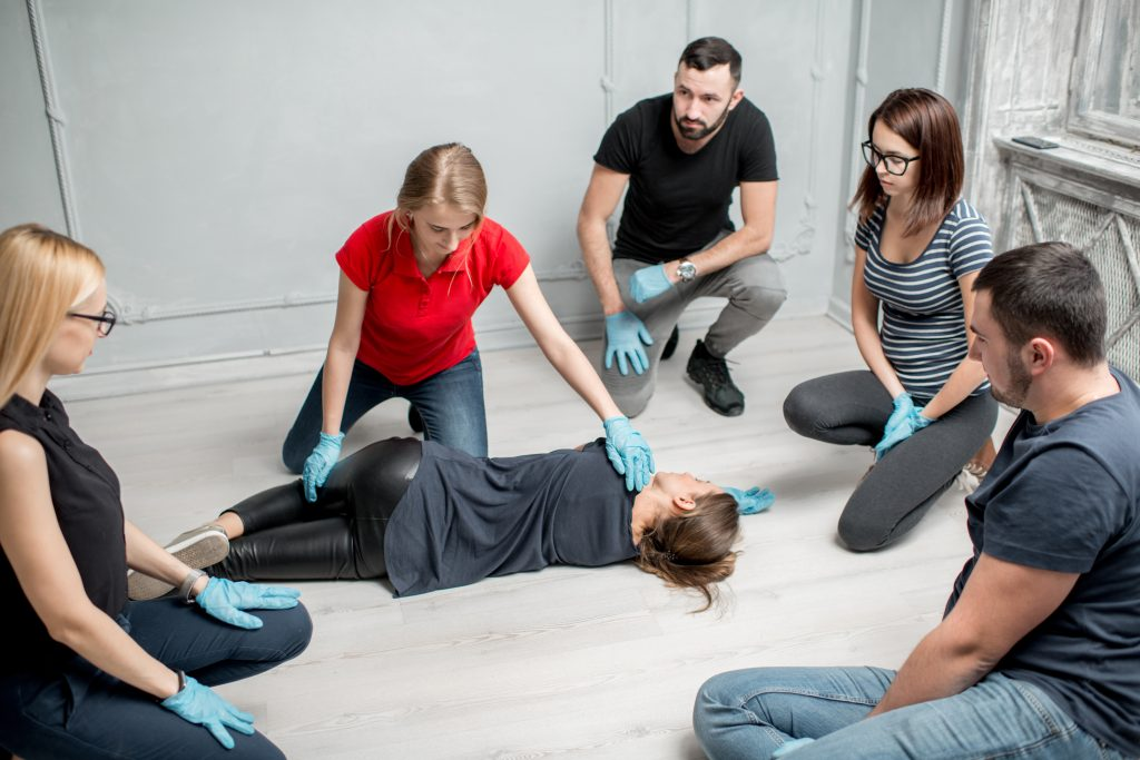 First Aid instructor teaching recovery position