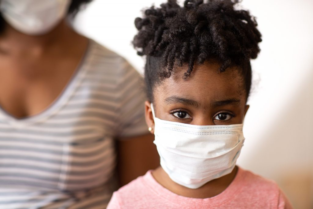 African American girl with face mask on.