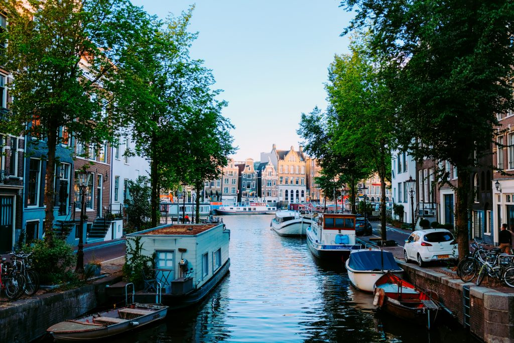 house boats docked on water canal