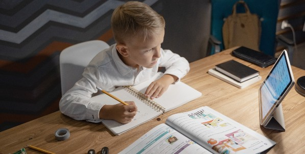 young boy in online learning